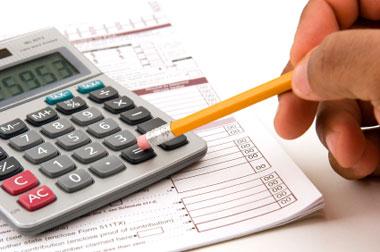 Calculator-and-paperwork